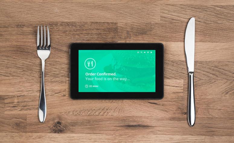 fork tablet knife on wood