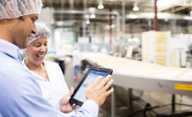 Meat & Poultry Workers Look at Tablet