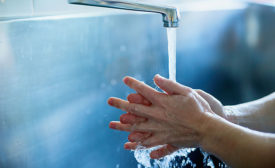 Employee Washing Hands