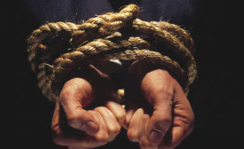 Hands Tied Together with Rope