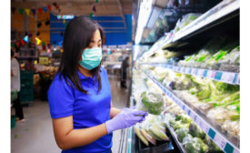 Woman mask shopping produce