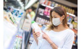 Woman reading milk label