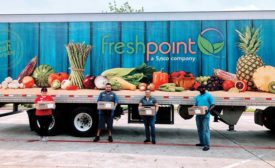 a truck and people holding produce